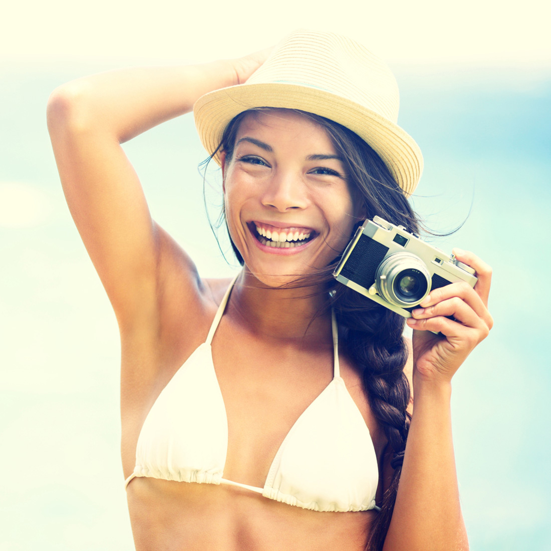 Beach woman with vintage retro camera